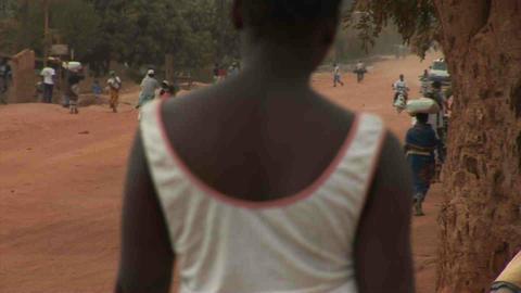 Dusty Road, people walking by Stock Video Footage