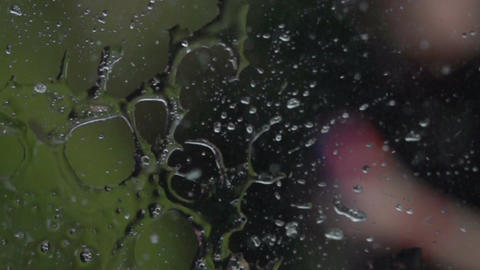 Water spray on window slowmotion 400fps Stock Video Footage