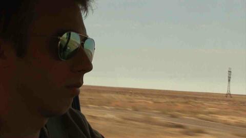 Guy Driving Landrover Sunglasses Kazakhstan Stock Video Footage
