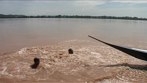 Don Khong, boys jumping in water from clif Stock Video Footage
