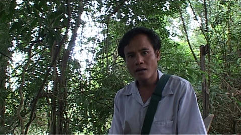 Boloven Plateau, guide say welcome in lao Stock Video Footage