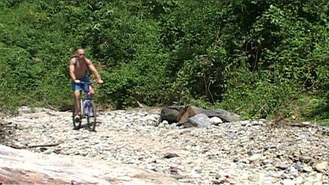 Vang Vieng, Karst hill landscape, mountainbike Stock Video Footage