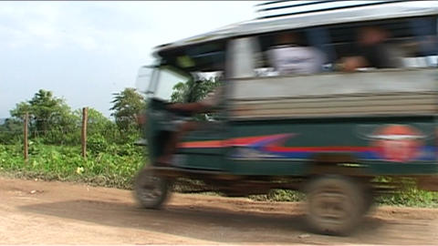 Vang Vieng tuktuk passing by Footage
