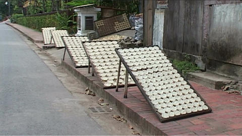 Luang Prabang rice cookies drying in the sun Stock Video Footage