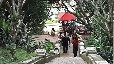 Mount Phu Si, tourists climbing on chairs Stock Video Footage