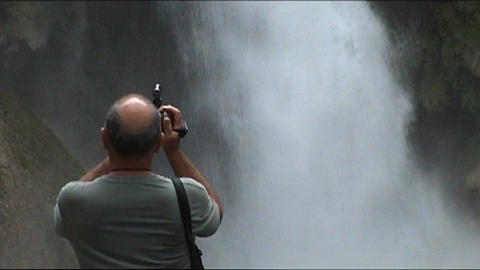 Luang Prabang, Kuang Si waterfall, cameraman in fr Stock Video Footage