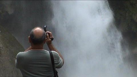 Luang Prabang, Kuang Si waterfall, cameraman in fr Stock Video Footage