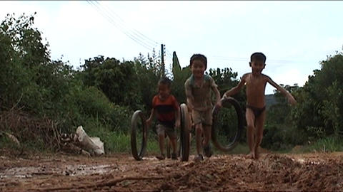 Children playing with wheels in water Stock Video Footage