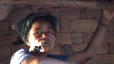 Ban Nalan Khamu village, woamn with pipe Stock Video Footage