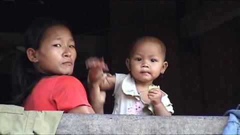 Ban Nalan Khamu village, girl waves Stock Video Footage