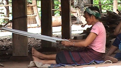 Khmu woman makes fish baskets Footage