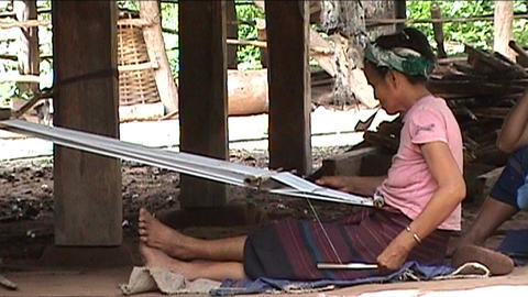 Khmu woman makes fish baskets Stock Video Footage