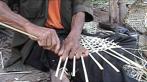 Khmu man makes fish baskets Stock Video Footage