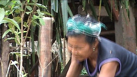 Khmu woman is pounding rice Stock Video Footage