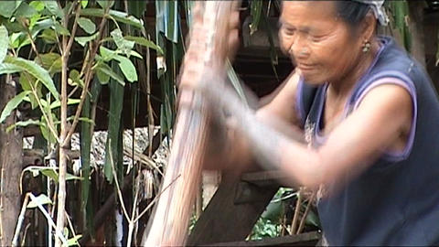 Khmu woman is pounding rice Footage