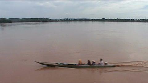 Longboat passing by on Mekong Footage