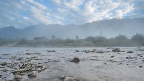 Morning fog in mountains and mountain river (Timel Footage