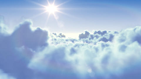 Flying over the clouds with the afternoon sun. Sea Stock Video Footage
