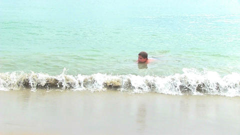 Teenage boy swimming in tropical sea Footage