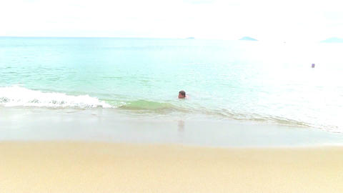 Teenage boy swimming in tropical sea Stock Video Footage