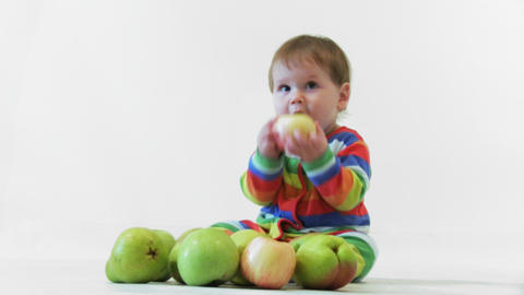 Adorable child with apples Footage