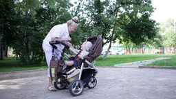 Granny playing with her grandson in the yard Footage