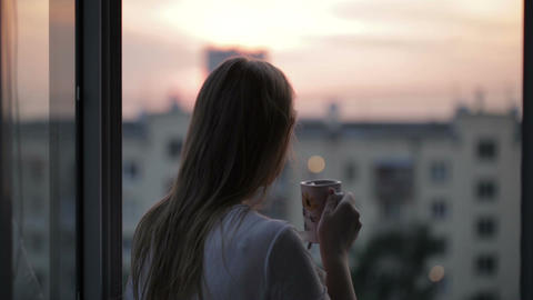 Woman At The Balcony The End Of A Hard Day stock footage