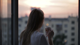 Woman at the balcony the end of a hard day Stock Video Footage