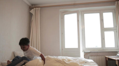 Teenager jumps on the bed Footage