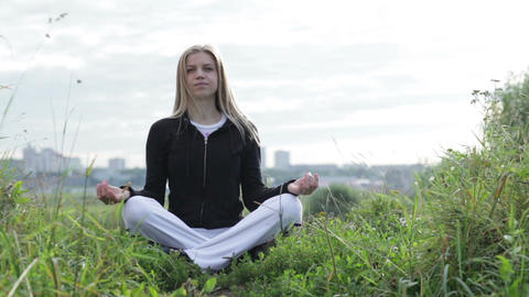 Yoga Exercises Outdoors Meditating stock footage