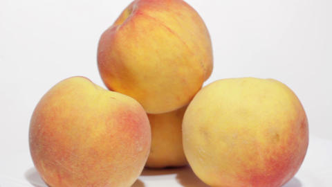 Fresh Peaches on White Plate Stock Video Footage