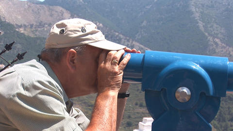 Man looks through telescope Stock Video Footage