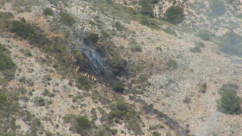 Firefighters battle brushfire Stock Video Footage