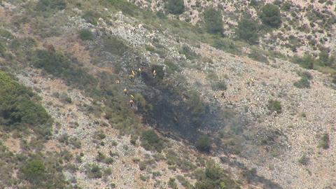 Firefighters battle brushfire Footage