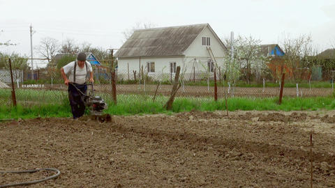 working man with motor cultivator Stock Video Footage