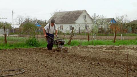 working man with motor cultivator Footage