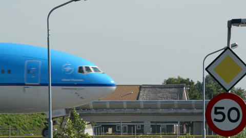 KLM airplane on taxiway with a speed sign 11036 Footage