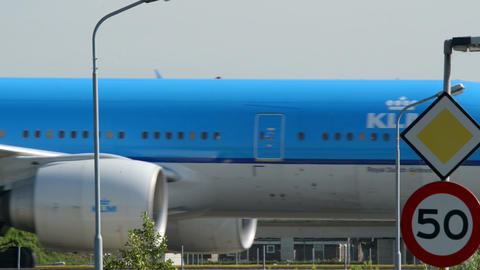 KLM airplane on taxiway with a speed sign 11036 Stock Video Footage