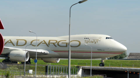 ETIHAD Cargo Boeing 747 Jumbo airplane taxiway 110 Stock Video Footage