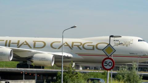ETIHAD Cargo Boeing 747 Jumbo airplane taxiway 110 Stock Video Footage