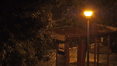 Empty bus stop in the rain Stock Video Footage