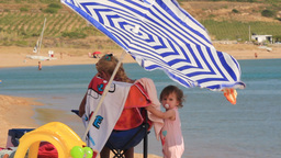 A BABY,MOTHER AND PARASOL Stock Video Footage