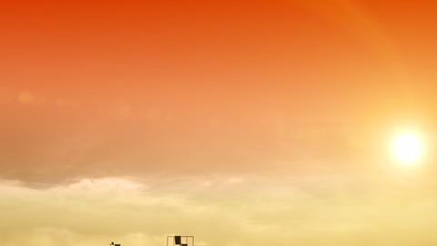 Growing buildings on orange sky with the sun. HD 1 Stock Video Footage