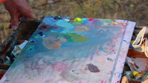 Artist Paints a Picture 3 Stock Video Footage