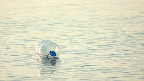 Bottle Swinging on Waves 1 Stock Video Footage