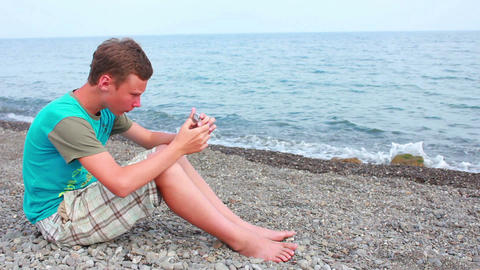 Boy on Beach with Phone 3 Footage