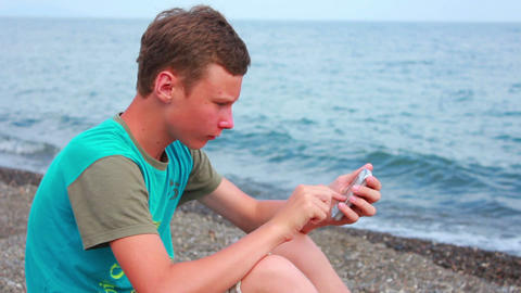 Boy on Beach with Phone 3 Stock Video Footage