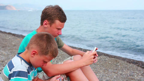 Boy on Beach with Phone 6 Stock Video Footage
