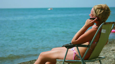 Woman Talking On The Phone At The Beach 2 stock footage