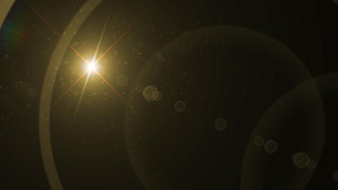 Lens Flares crossing gold Stock Video Footage